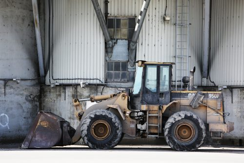 Canva - Yellow and Black Payloader Parked Beside Building